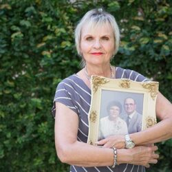 Older woman holding picture frame