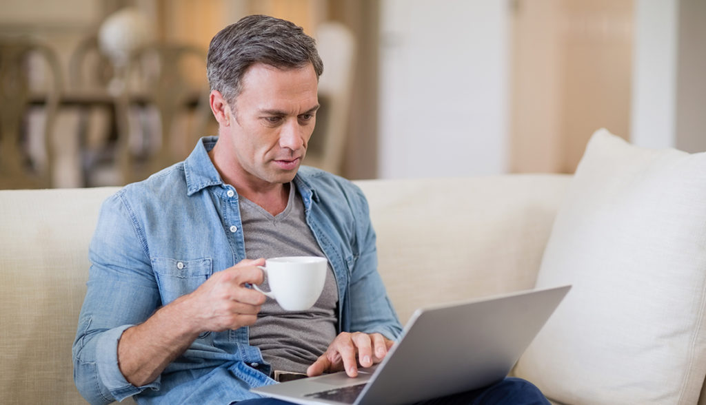 mature man working on computer