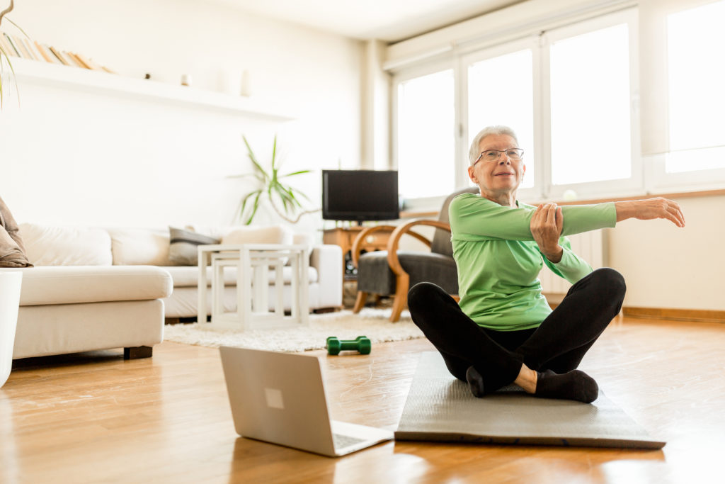 older woman exercising at home
